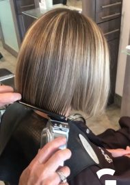 Clipper hair cut for a sharp lob effect