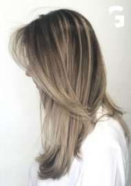 Sandy blonde highlights on a brunette