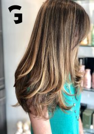 honey balayage and babylights long layers haircut
