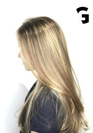 light blonde hair painting balayage on long hair.
