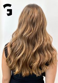golden balayage on long loose waves